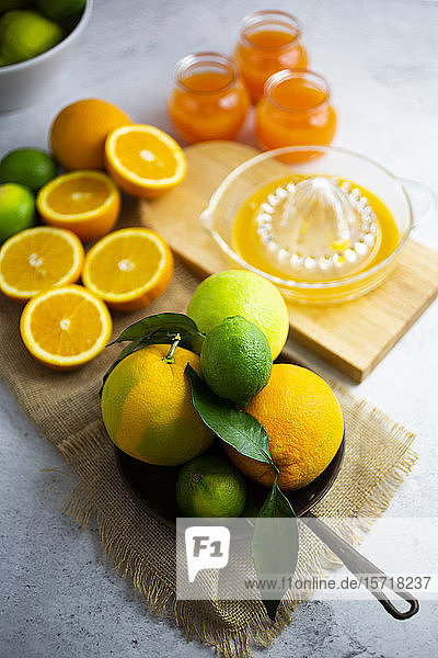 Heap of ripe citrus fruits on frying pan