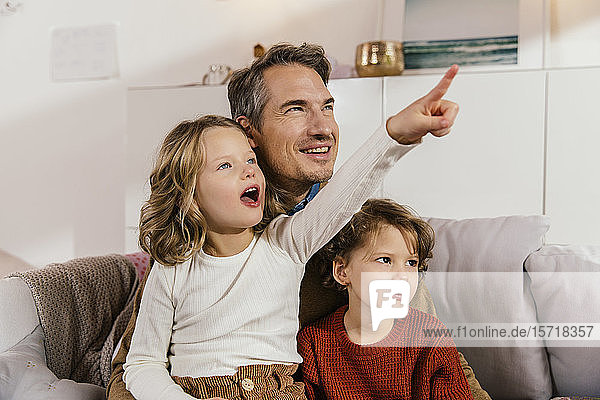 Daughter showing something to father at home