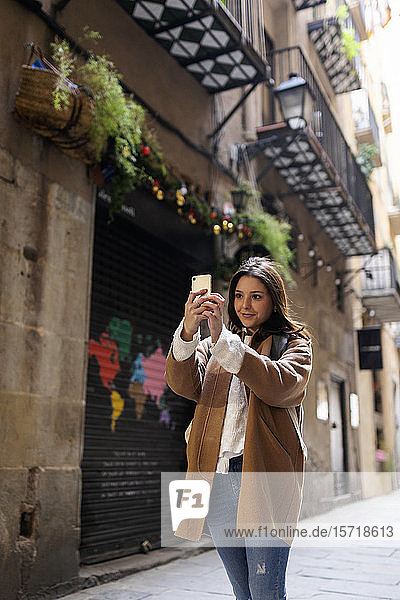 Young woman taking a selfie in the city  Barcelona  Spain