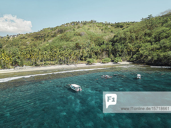 Indonesia  Bali  Boats floating in water at coast of Nusa Penida island