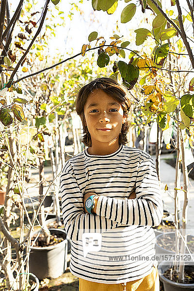 Portrait of boy at plant nursery