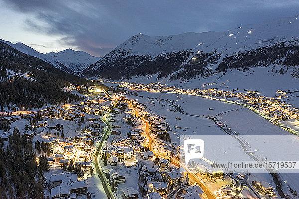 Italy  Province of Sondrio  Livigno  Aerial view of illuminated town in Italian Alps at dusk