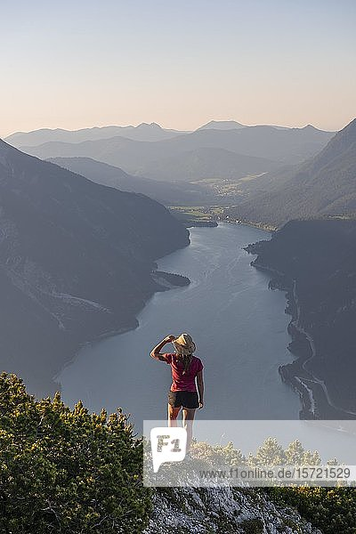 Young woman looking over mountain landscape  view from the mountain Bärenkopf to Lake Achensee  Tyrol  Austria  Europe