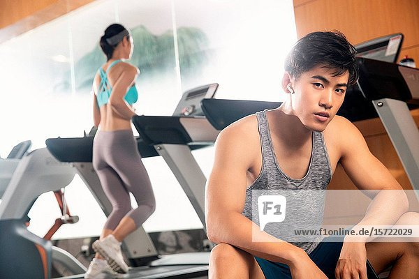 Young people in the gym to work out