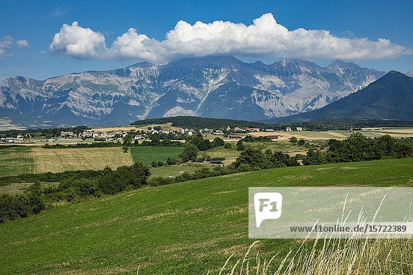 Panoriamic of The mountains of the Cuchon and Petite Autane with the village of Les Faix  Champsaur  French Alps in summer. Hautes-Alpes.