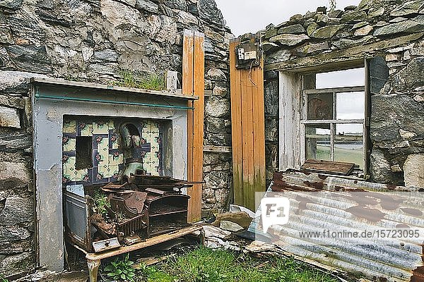 Tiled area with flue and rusting cooker in an abandoned crofters house  Isle of Lewis and Harris  Outer Hebrides  Scotland