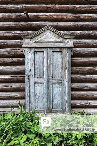 The closed window of the old log house.