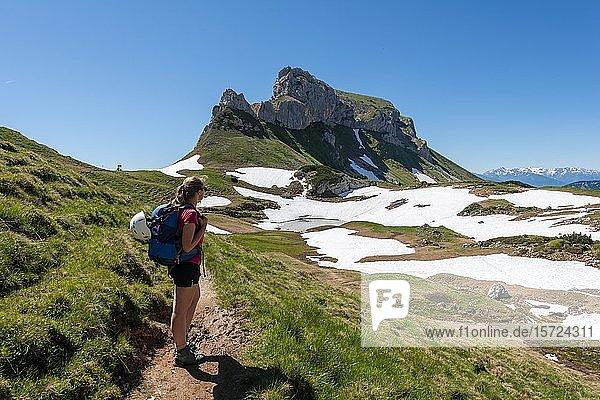 Young woman on a hiking trail  Haidachstellwand  5-summit via ferrata  hike on the Rofan mountains  Tyrol  Austria  Europe