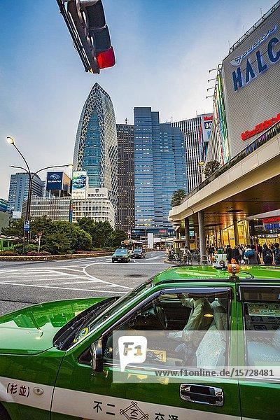 Shinjuku station. In the background Mode Gakuen Cocoon Tower by Kenzo Tange and Noritaka Tange. Shinjuku district  Tokyo  Japan  Asia.