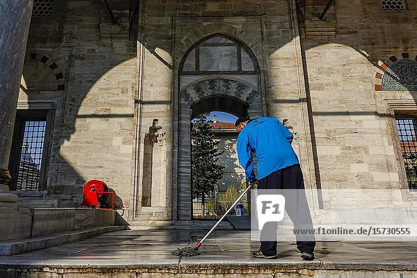 Istanbul  Turkey A man cleans the marble floors outside of the Yavuz Sultan Selim Mosque in the Balat neighborhood.