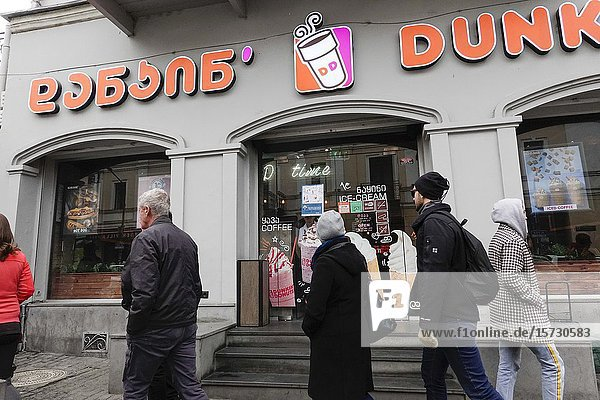 Tbilisi  Georgia A Dunkin Donuts shop and pedestrians in the downtown.