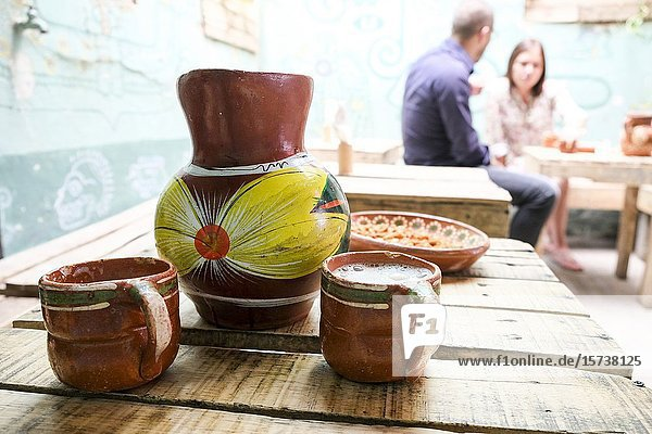 Terracotta jar with fresh and delicious pulque. Guadalajara  Jalisco. Mexico.
