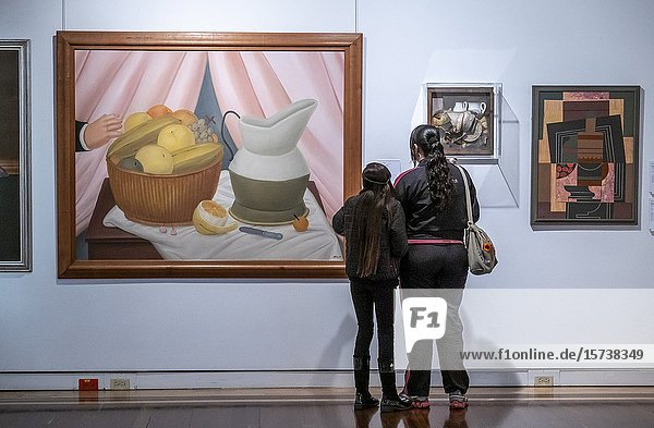 Women observing `Still Life'  by Fernando Botero. Modernities hall  National Museum of Colombia  Bogota  Colombia.