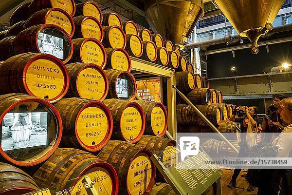 Guinness story on the TV- barrels  at Guinness Storehouse  museum  brewery  exhibition  Dublin  Ireland.