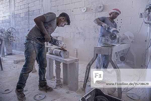 Nader 15 years old  modeling the famous rock from Arsal  working with dangerous machinery  child labour  syrian refugee  in Arsal  Bekaa Valley  Lebanon.