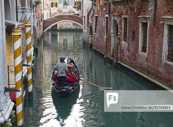 Gondola in a small canal  Venice  Italy.