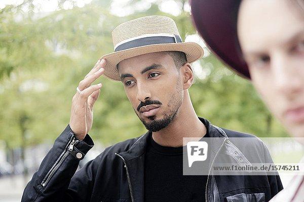 Two men wearing hats. Munich  Germany.