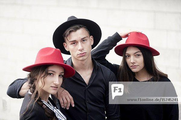 Man and two women wearing hats. Munich  Germany.