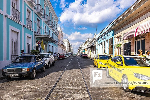 Taxis in the streets of Cienfuegos  Republic of Cuba  Caribbean  Central America.