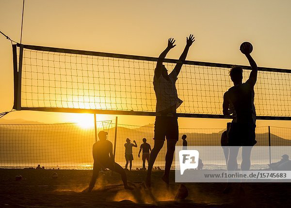 Beach volleyball at sunset on Las Canteras beach in Las Palmas  Gran Canaria  Canary Islands  Spain.