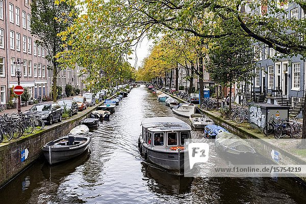 Amsterdam  Netherlands. One of the famous Amsterdam Canals with a huge collection of leisure boats and vessels.