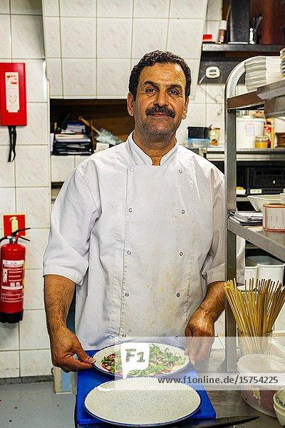 Den Bosch  Netherlands. Portrait of an immigrant Chef inside his Restaurant Kitchen.