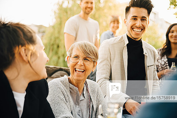 Male and female friends enjoying at garden party