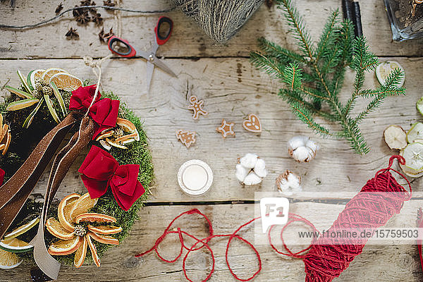 Variety of Christmas ornaments and craft on wooden table