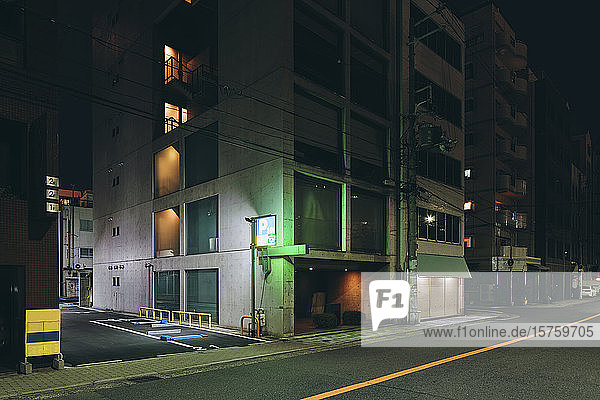 Night scene of multistorey office buildings  Osaka  Japan