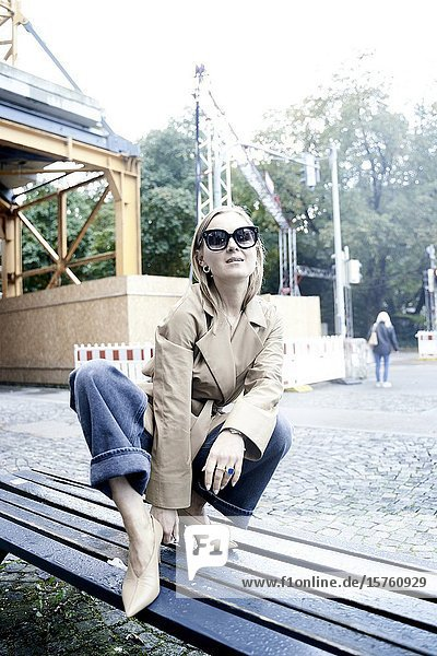 Fashionable woman on bench. Munich  Germany.