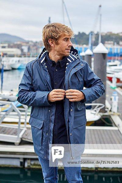Mid-adult man  Marina  Pasai Donibane  Pasaia Port  Gipuzkoa  Basque Country  Spain  Europe