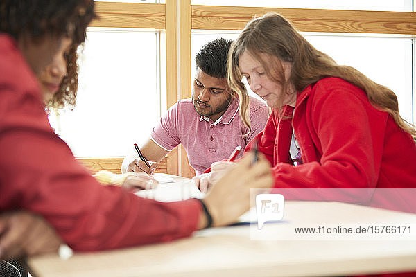 Focused college students studying in classroom