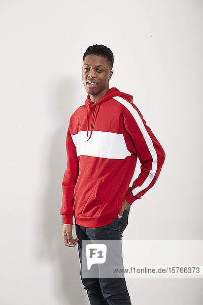 Portrait confident young man in hoody