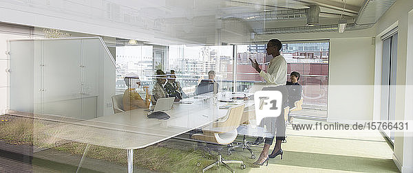 Businesswoman leading conference room meeting Businesswoman leading conference room meeting