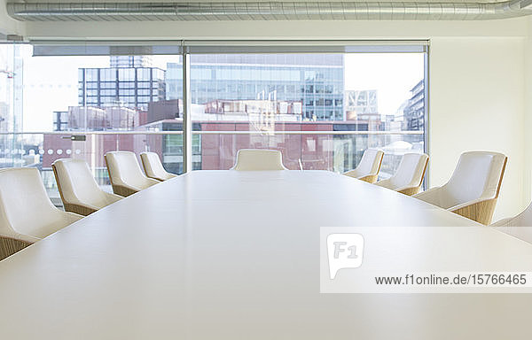 Conference telephone on conference table in urban office Conference telephone on conference table in urban office