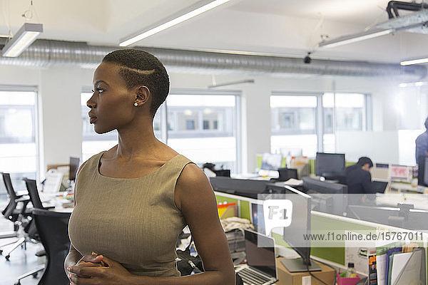 Pensive businesswoman in open plan office Pensive businesswoman in open plan office