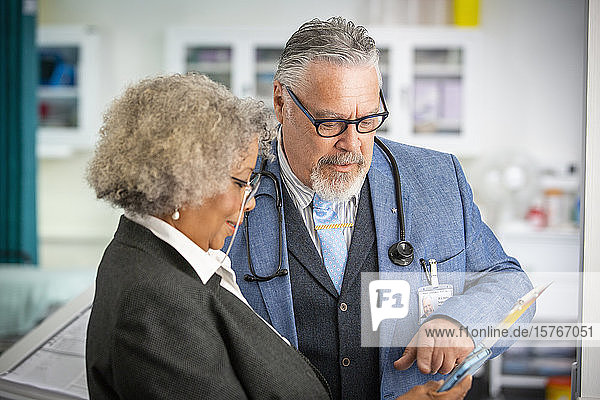 Senior doctors using digital tablet in hospital Senior doctors using digital tablet in hospital