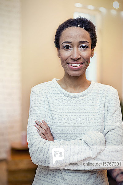Portrait confident  smiling woman with arms crossed