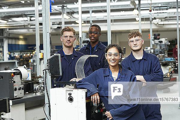 Portrait confident college students in shop class