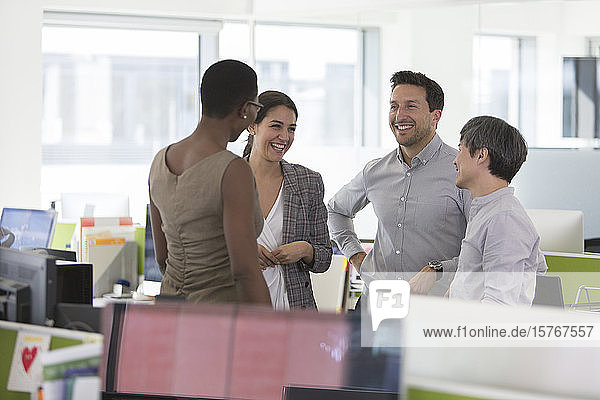 Smiling business people talking  meeting in office