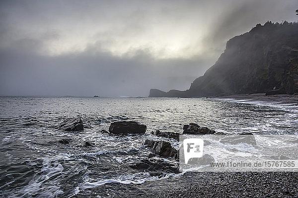 Tranquil rocky ocean beach Playa de Portizuela Spain