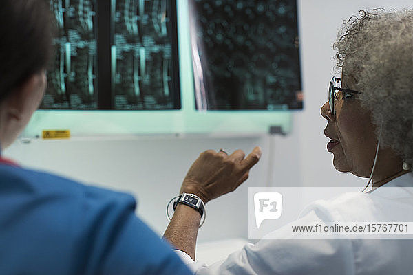 Female doctors discussing x-rays in hospital