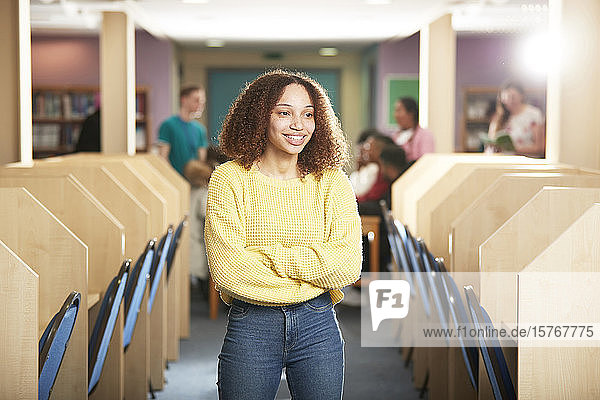 Portrait confident young female college student in computer lab