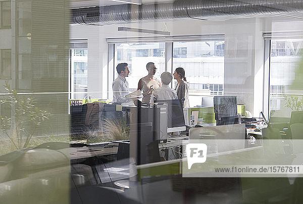 Business people talking  meeting in open plan office Business people talking, meeting in open plan office