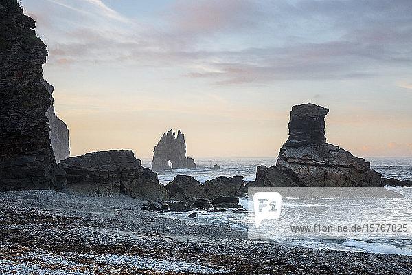 Rock formations in ocean Portizuela Beach Asturias Spain