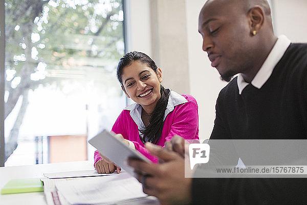 Business people using digital tablet in meeting Business people using digital tablet in meeting