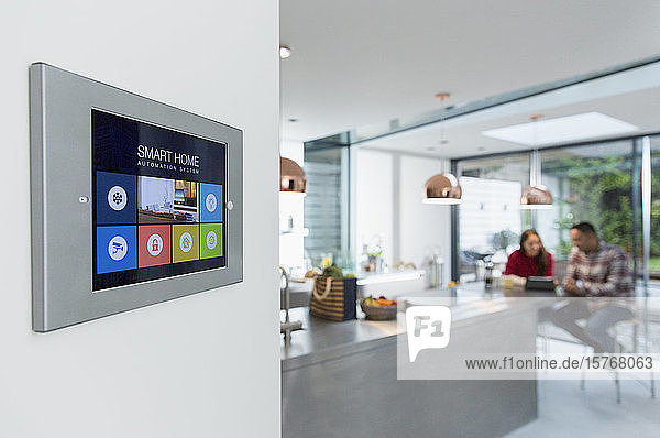 Smart home navigation system touch screen on kitchen wall