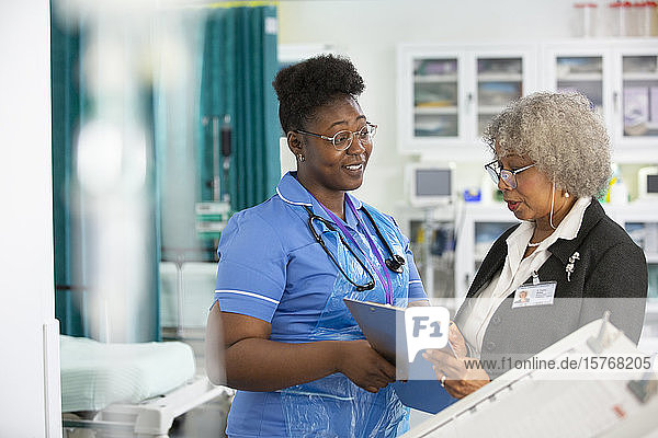 Female doctor and nurse making rounds in hospital