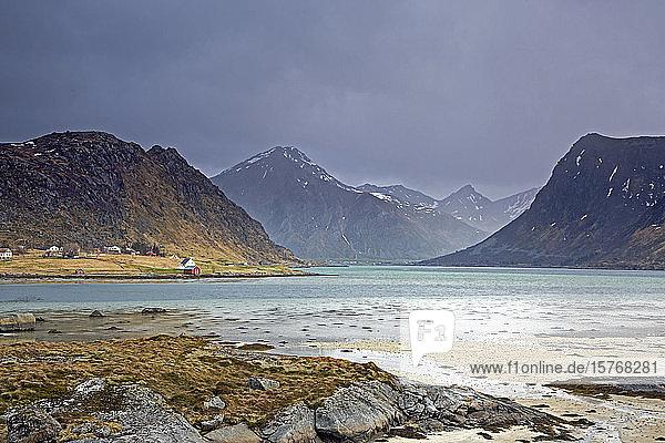Scenic view mountains and ocean Flakstadpollen Lofoten Norway