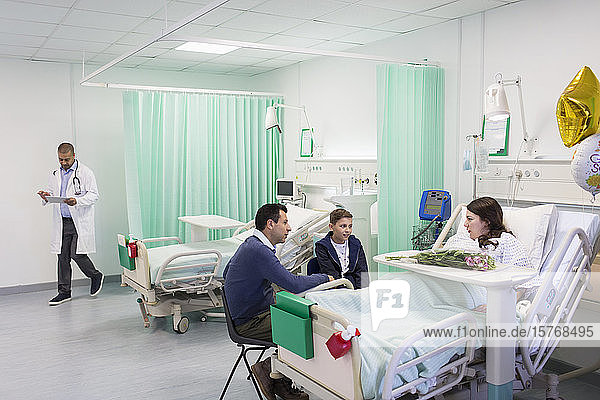 Family visiting patient in hospital ward
